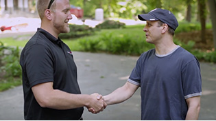Victor's Roofing Roofer Shaking hands with homeowner